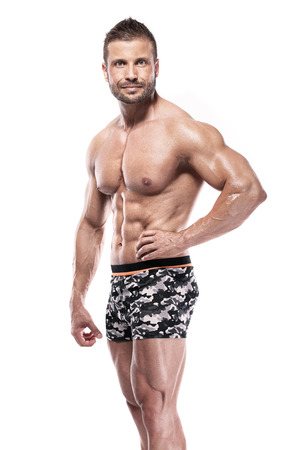 sixpack: man bodybuilder showing muscular body over white background