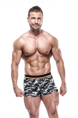 man bodybuilder showing muscular body over white background
