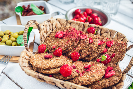 healthy homemade strawberries biscuits from oat flakes laid on a white garden rustic table 版權商用圖片