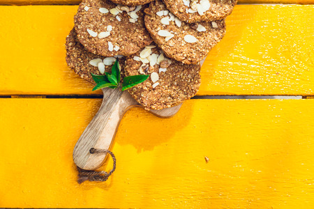 healthy homemade strawberries biscuits from oat flakes laid on a white garden rustic orange table