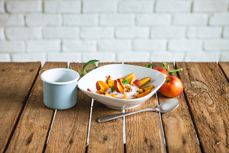 morning breakfast with fruit and yogurt on the wooden table