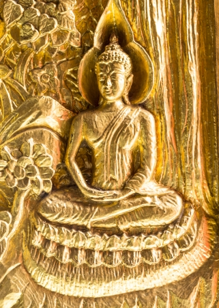 Golden Buddha (statue) on the door in Wat phra Taen Sila Art, Uttaradit, Thailand. Reklamní fotografie