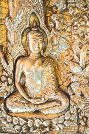 Metal buddha on the door in Wat phra Taen Sila Art, Uttaradit, Thailand.