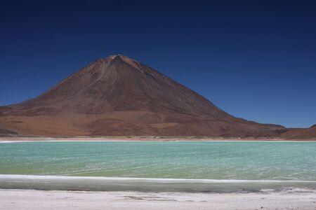lipez: Laguna Verde and Licacanbur volcano on the Sud Lipez Altiplano  Stock Photo