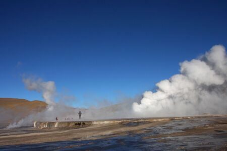 Steam of geysers in the morning light of Altiplano Stock Photo