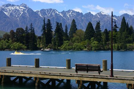 Remarkables mountains over the park and the lake near Queenstown