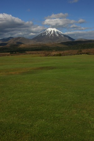 ot: Nguaruhoe volcano over the green grass ot the golf Stock Photo