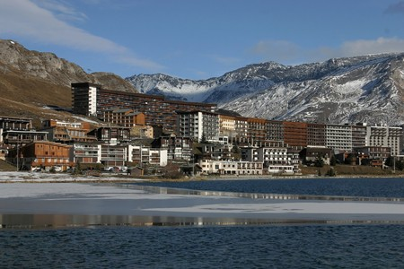 The lake and the village of Tignes in french alps Stock Photo