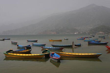 pokhara: Boats on Phewa Lake in Pokhara Stock Photo