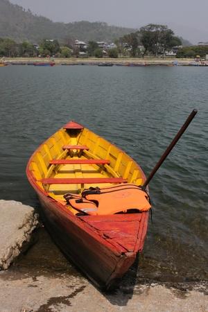 Boats on Phewa Lake in Pokhara photo