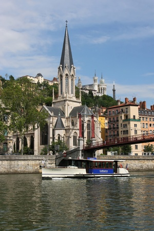 confluence: LYON, FRANCE, may 20 : The Confluence Vaporetto commemorates its first month of service on Saone river. The boat service transports 70 persons in 20 mn from the city center to Confluence, the first french recreation and shop center served by river shuttle