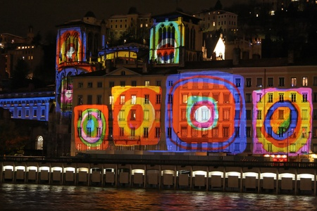 expresses: LYON, FRANCE - DECEMBER 7 : Festival of Lights in the streets of Lyon on December 7, 2012 in Lyon, France. The Festival of Lights expresses gratitude toward Mary, mother of Jesus around December 8 of each year Editorial