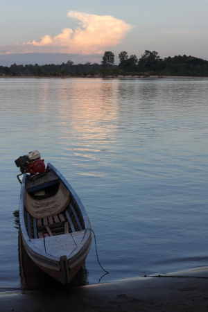 Fishermen boat on Mekong river at the dusk photo