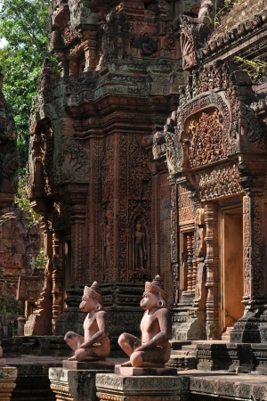 Banteay Srei temple doors and statues Stock Photo