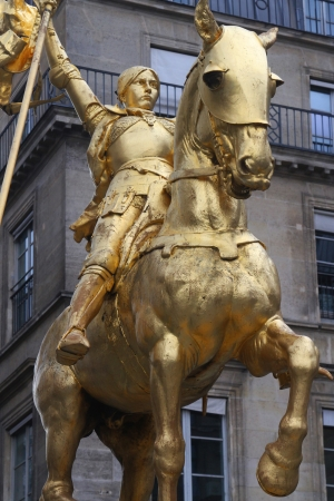 Golden statue of Joan of Arc in Paris photo