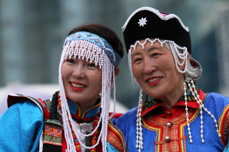 ULAN BATAAR, MONGOLIA, JULY, 20 - People in traditional clothes during Naadam midsummer festival, on July 20, 2013 in Ulan Bataar, Mongolia  Naadam is inscribed on the Representative List of the Intangible Cultural Heritage of Humanity