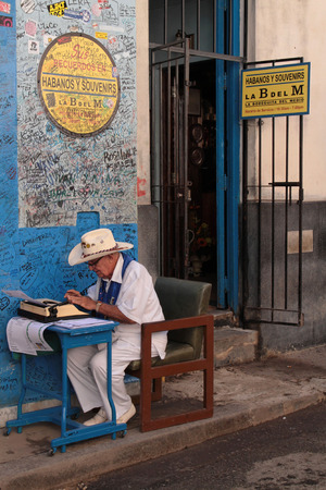 HAVANA, CUBA, FEBRUARY 15, 2014   Bodeguita del Medio is a famous tourist destination because of the personalities which have patronized it0   the poet Pablo Neruda, the writer Ernest Hemingway and many others