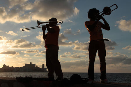 HAVANA, CUBA, FEBRUARY 15, 2014   Musicians in the sunset of Havana  Havana is the largest city in the Caribbean and its center is inscribed on Unesco World Heritage list