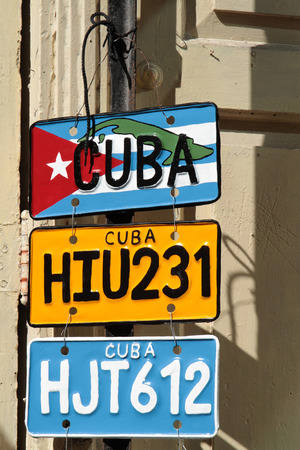 HAVANA, CUBA, FEBRUARY 16, 2014   Cuban license plates for sale in the streets of Havana  Classic cars are still in use in Cuba and old timers have become an iconic view and a worldwide known attraction