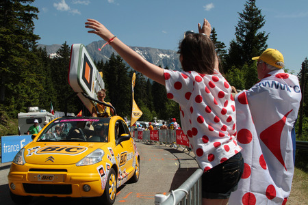 CHAMROUSSE, FRANCE, JULY 18, 2014   Publicity caravan of the Tour de France  A convoy of vehicles with advertising character, before the passage of the runners, distributes objects of all kinds
