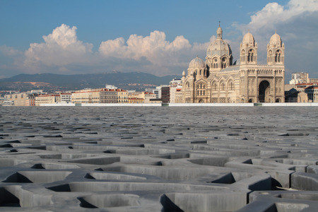 civilizations: MARSEILLE, FRANCE, OCTOBER 2, 2014 : The roof of fibre-reinforced concrete of the Museum of European and Mediterranean Civilizations (MuCEM) in Marseille with Cathedral in the background.
