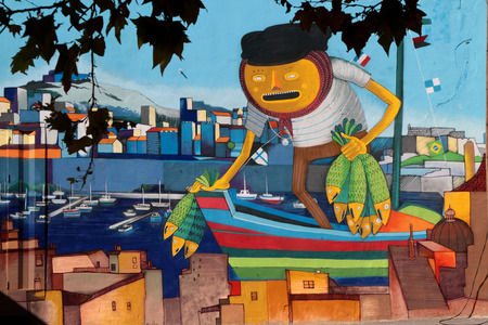 MARSEILLE, FRANCE, OCTOBER 2, 2014 : Fisherman painted on a wall in City Center. Marseilles is the 3rd-largest metropolitan area in France, and largest city on the Mediterranean coast and largest commercial port.