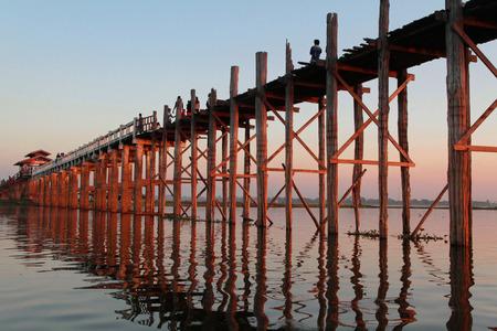 MANDALAY, MYANMAR, December 11, 2014 : U-Bein bridge at sunset. The 1,5 kilometre bridge was built around 1850 and is believed to be the oldest and longest teakwood bridge in the world.