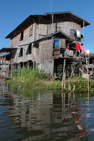 generative: INLE LAKE, MYANMAR, December 15, 2014 : The tribe of Inthar, which populates the region, built on the water its houses on piles and lives on generative culture of fruits, vegetables and flowers on incredible floating islands Editorial