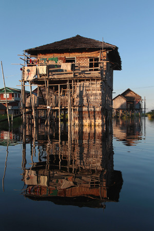 est: INLE LAKE, MYANMAR, December 15, 2014 : The tribe of Inthar, which populates the region, built on the water its houses on piles and lives on generative culture of fruits, vegetables and flowers on incredible floating islands Editorial