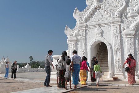 min: MANDALAY, MYANMAR, December 12, 2014 : Hsinbyume Pagoda in Min Gun village. The pagoda is painted white and is modeled on the physical description of the Buddhist mythological mountain, Mount Meru