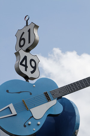 mastery: CLARKSDALE MISSISSIPPI May 8 2015 : Guitars show the junction of US 61 and US 49 in Clarksdale often designated as the famous crossroads where according to legend Robert Johnson sold his soul to the Devil in exchange for mastery of the blues Editorial