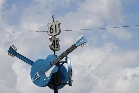 CLARKSDALE MISSISSIPPI May 8 2015 : Guitars show the junction of US 61 and US 49 in Clarksdale often designated as the famous crossroads where according to legend Robert Johnson sold his soul to the Devil in exchange for mastery of the blues Editorial