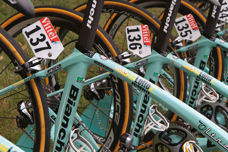 to depart: PAU, FRANCE, July 15, 2015 : Numbers on the runners bikes in the Village Depart of the Tour de France cyclist race. Editorial