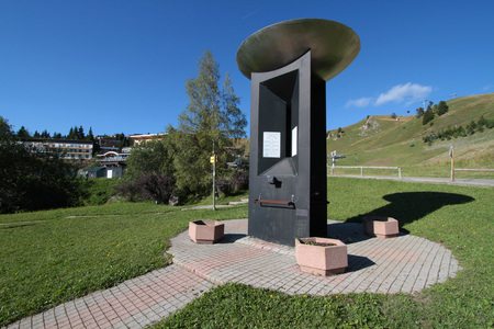stele: CHAMROUSSE, FRANCE, August 20, 2015 : At the entrance of the mountain resort of Chamrousse, a stele commemorates the 1968 Olympic Winter Games. Alpine skiing events took place in Chamrousse.