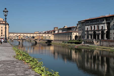 ponte vecchio: Arno river banks and Ponte Vecchio Stock Photo