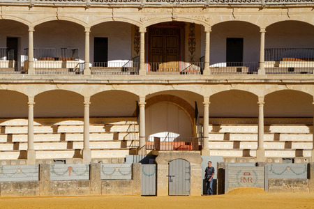 involves: RONDA, SPAIN, October 22, 2015 : The Plaza de toros de Ronda, built in 1774, is the oldest bullfighting ring in Spain. Corrida involves professional toreros who execute various formal moves. Editorial