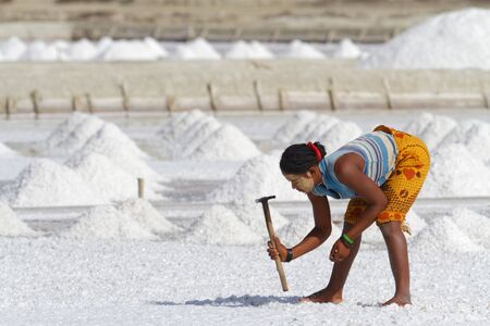 BELO, MADAGASCAR, November 24, 2015 : People works in salt evaporation ponds near Belo-sur-Mer, to extract salts from sea water. Editorial