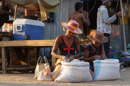 majority: BELO-SUR-TSIRIBHINE, MADAGASCAR, November 20, 2015 : At the market. The majority of the population of the commune are farmers and the most important crop is rice.