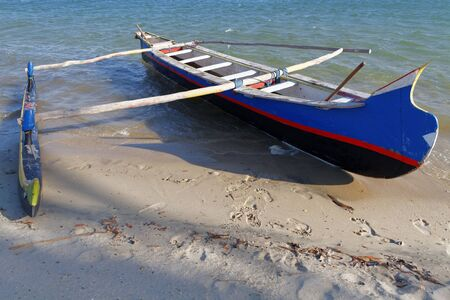 outrigger: BELO, MADAGASCAR, November 24, 2015 : Traditional fisherman pirogue on the beach. The outrigger canoes are used by Vezo fishermen, a semi-nomadic coastal people of southern Madagascar.