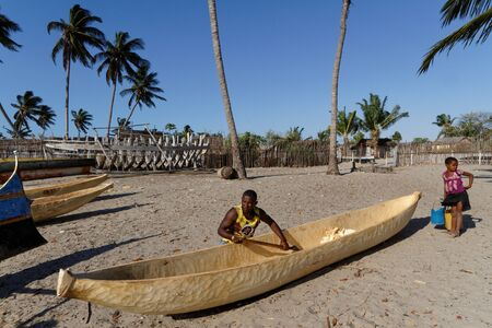 outrigger: BELO, MADAGASCAR, November 24, 2015 : Building of a traditional pirogue on the beach. The outrigger canoes are used by Vezo fishermen, a semi-nomadic coastal people of southern Madagascar.