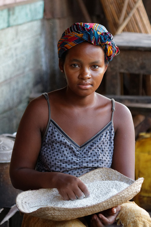 majority: BELO-SUR-TSIRIBHINE, MADAGASCAR, November 21, 2015 : Young lady at the market. The majority of the population of the commune are farmers and the most important crop is rice.