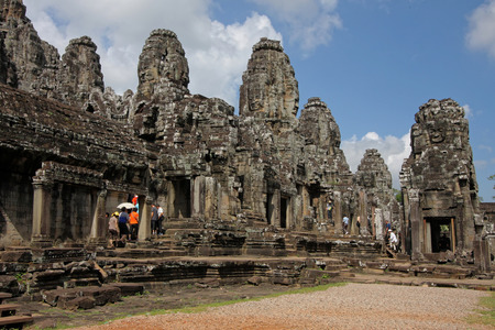 numerous: ANGKOR, Cambodia, November 30, 2012 : Asian tourists visit the Bayon temple, known for its numerous heads of stone. Editorial