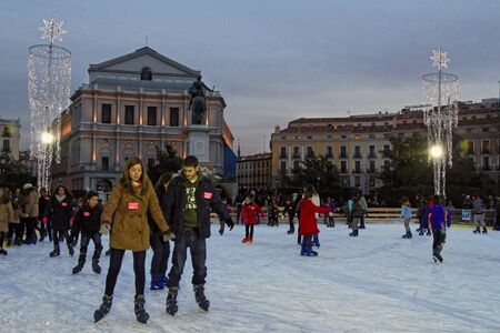 december 21: MADRID, Spain, December 21, 2013 : Skating during Christmas market that takes place on Plaza de Oriente in front of Palacio Real. Editorial