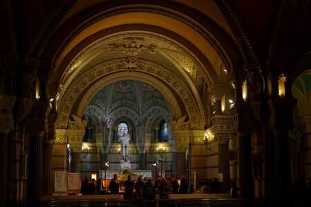 dominating: LYON, FRANCE, December 7, 2015 : Inside the crypt of Fourviere Basilica. The basilica was built with private funds between 1872 and 1884 in a dominating position in the city.