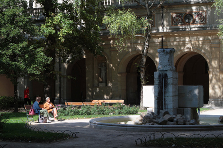 museum visit: LYON, FRANCE, September 27, 2015 : People visit the garden of the old Palais Saint-Pierre, which houses the Art Museum of the city.