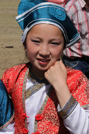 mongolia horse: KARKORIN, MONGOLIA, July 9, 2013 : Young dancer girl during Naadam. Naadam is a traditional festival where Mongolian wrestling, horse racing, and archery are held throughout the country during midsummer