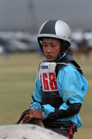 mongolia horse: KARKORIN, MONGOLIA, July 8, 2013 : Young boy rides during Naadam. Naadam is a traditional festival where Mongolian wrestling, horse racing, and archery are held throughout the country during midsummer. , Editorial