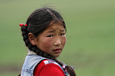 mongolian: BAT-ULZII, MONGOLIA, July 14, 2013 : Mongolian child. Nearly half of the people live in the capital, but semi nomadic life still predominates in the countryside. Editorial
