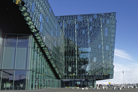 concert hall: REYKJAVIK, ICELAND, March 8, 2016 : Harpa is a concert hall and conference centre in Reykjavík. The structure consists of a steel framework clad with geometric glass panels of different colours