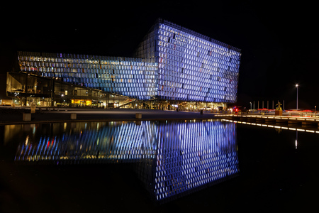 symetry: REYKJAVIK, ICELAND, March 8, 2016 : Harpa is a concert hall and conference centre in Reykjavík. The structure consists of a steel framework clad with geometric glass panels of different colours